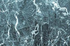 Textur av mångfärgat en marmor eller en tegelplatta med vita fläckar och modeller royaltyfria foton
