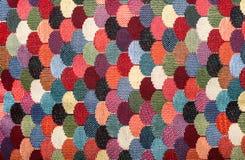 Textur av mångfärgat tyg Arkivfoto