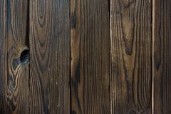 Textur av mörka bruna bräden arkivfoto