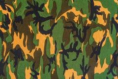 Textur av militärt kamouflagetyg Royaltyfria Foton
