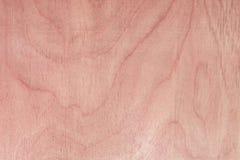Textur av naturlig björkkryssfaner, yttersidan av trät har gnidits med sandpapper och har skrapats Arkivfoto