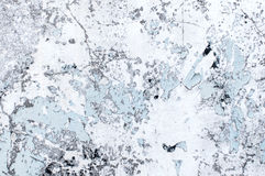 Textur av nedfläckade grå färger hårdnar med skalad målarfärg och den knäckte bortförklaringen Royaltyfri Foto