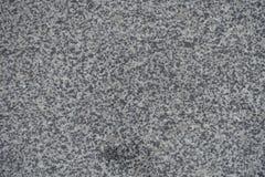 Textur av polerad grå granit från över Arkivfoto