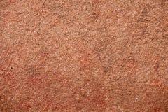 Textur av röd granit Arkivbild