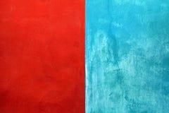 Textur av röd och blå sjaskig målarfärgstuckaturbakgrund Fotografering för Bildbyråer