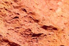 Textur av röd stenig jordbakgrund på Seychellerna Royaltyfri Fotografi