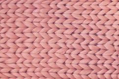 Textur av rosa färgrät maskafilten Stort handarbete Plädmerinoull Top beskådar arkivbilder