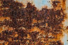 Textur av rostigt järn, sprucken målarfärg på en gammal metallisk yttersida, Fotografering för Bildbyråer