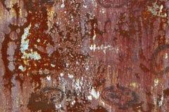 Textur av rostigt järn, sprucken målarfärg på en gammal metallisk yttersida arkivbild