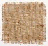 Textur av säckvävhessiansfyrkanten med slitna kanter Arkivbilder