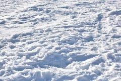 Textur av snöig jordning Fotografering för Bildbyråer