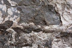 Textur av stenväggen för design Fotoet av stenen vaggar textur Grunden för baner, stenar den texturerade websiten royaltyfri fotografi