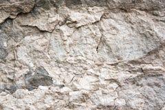 Textur av stenv?ggen f?r design Fotoet av stenen vaggar textur Grunden f?r baner, stenar den texturerade websiten royaltyfri bild