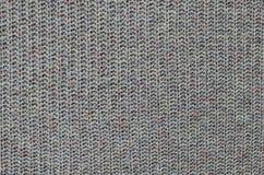 Textur av stuckit woolen tyg arkivfoto