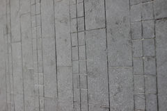 Textur av tegelplattor för grå färgfyrkantstenläggning på den hela ramen Royaltyfri Bild