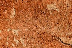 Textur av väggen som målas med röd ledning Fotografering för Bildbyråer