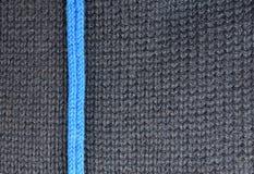 Textur av woolen stucken bakgrund för grått och blått band Arkivbilder