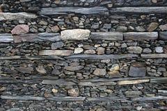 Textur, bakgrund av olika format för stenar och färger väggarna Royaltyfria Foton