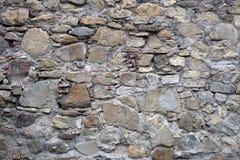 Textur, bakgrund av olika format för stenar och färger väggarna Royaltyfri Fotografi