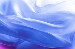 Textur bakgrund, modell blå tygsilk Abstrakt backgro Arkivbilder