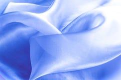 Textur bakgrund, modell blå tygsilk Abstrakt backgro Arkivfoton
