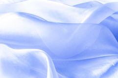 Textur bakgrund, modell blå tygsilk Abstrakt backgro Arkivbild