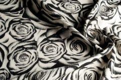 Textur bakgrund, modell En woolen halsduk som är svartvit, r Arkivbilder