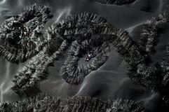 Textur bakgrund, modell svart tygsilk Med sydd patte Royaltyfria Bilder