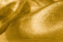 Textur bakgrund, modell Tyg - siden- ljus Guld är yelloen Royaltyfri Bild