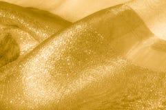 Textur bakgrund, modell Tyg - siden- ljus Guld är yelloen Fotografering för Bildbyråer
