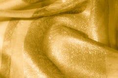 Textur bakgrund, modell Tyg - siden- ljus Guld är yelloen Arkivfoton