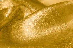 Textur bakgrund, modell Tyg - siden- ljus Guld är yelloen Arkivbild