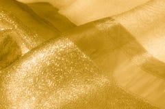 Textur bakgrund, modell Tyg - siden- ljus Guld är yelloen Royaltyfri Fotografi