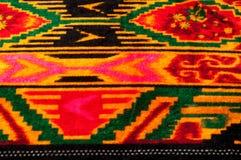 Textur bakgrund, modell Uzbekiska motiv för torkduk Indiskt tyg royaltyfri bild