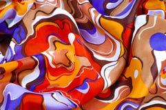 textur bakgrund, siden- tyg av en abstrakt färgläggning Abstr Arkivfoto