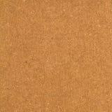 Textur eller bakgrund för brunt papper. Arkivfoton