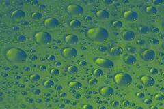 Textur för bakgrund för vattendroppar grön Arkivbild