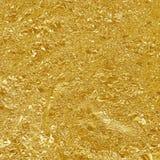 Textur för blad för guld- folie skinande, gult inpackningspapper för abstrakt begrepp Arkivbilder