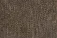 Textur för brunt papper med att utföra i relief och stämpling royaltyfri fotografi