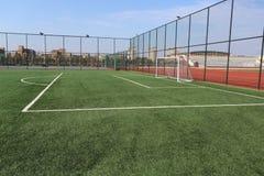 textur för green för gräs för bakgrundsfältfotboll Royaltyfri Bild