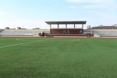textur för green för gräs för bakgrundsfältfotboll Royaltyfri Foto