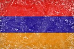 Textur för GrungeArmenien flagga på kaprontyg Royaltyfri Foto