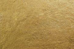 Textur för guld- folie guld- abstrakt bakgrund Arkivbild