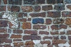 Textur för Lateritetegelstenvägg arkivfoton