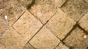 Textur för modell för fyrkantiga gamla stentegelstenar rhombic Arkivbild