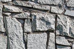 textur för mossrocksten Abstrakt bakgrund av den gamla kullerstentrottoarnärbilden Royaltyfri Foto