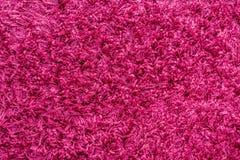 Textur för röd matta för vin, closeupbakgrund Arkivfoto
