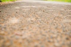 textur för solljus för sten för asfaltbakgrundsväg passande Arkivbilder