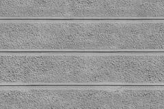 Textur för Tileable inryckade grov grå väggyttersida med tre horisontallinjer Royaltyfri Foto