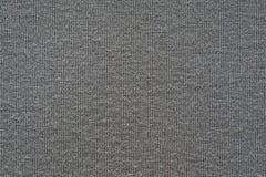 Textur från ett mjukt stuckit tyg av grå färger färgar Arkivfoton